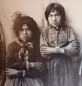 Two Tlingit girls, Tsacotna and Natsanitna, pose for a photograph in 1903. The nose rings are common ornaments among Indians of the Northwestern tribes, jewelry being a symbol of status.