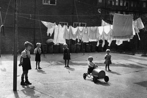 Young-children-playing-in-a-yard